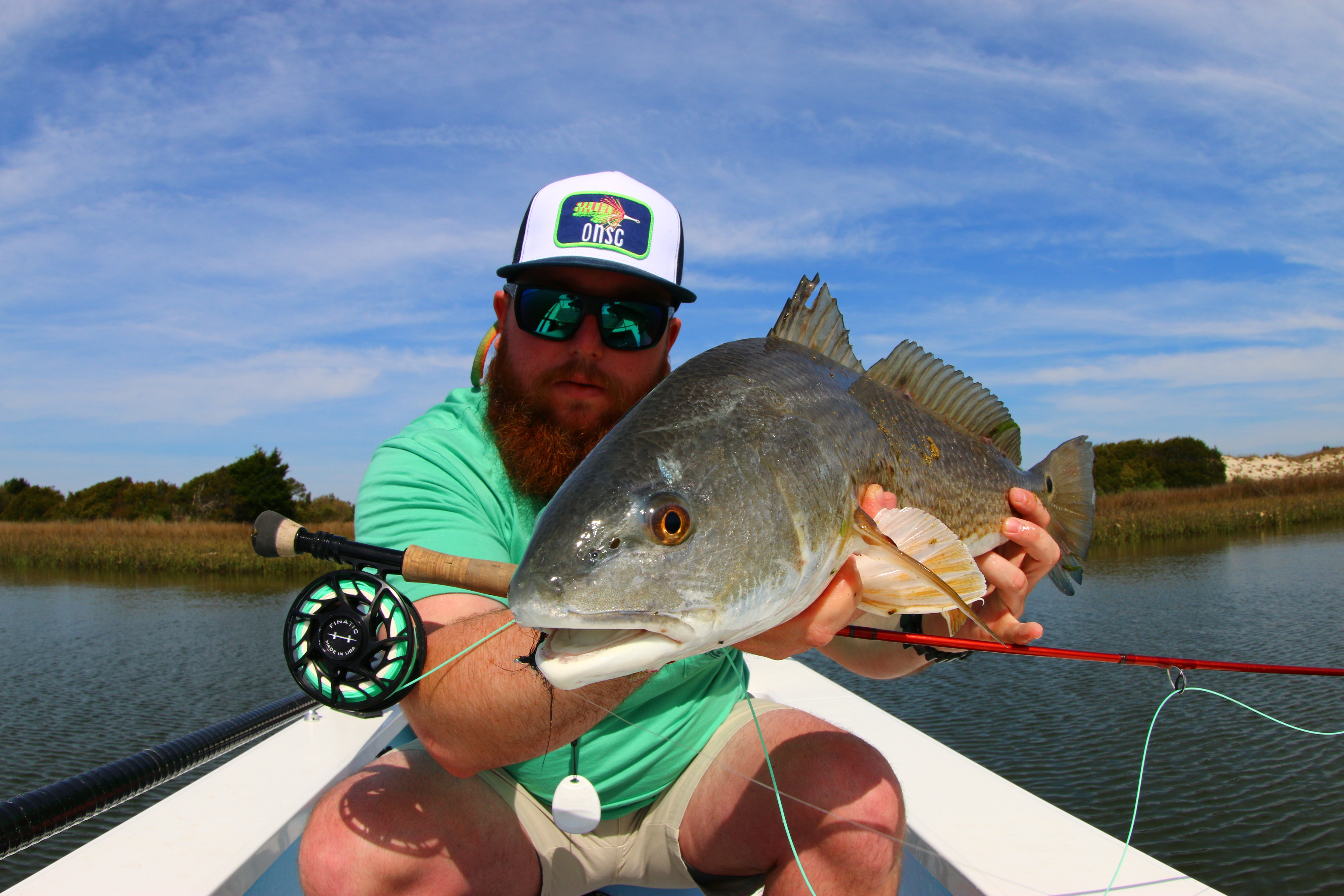 Reds on the fly fishing reports coastal carolina fisherman for Reds fly fishing